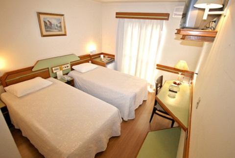 Apartamento duplo. Hotel Bella Itália, Foz do Iguaçu, PR. Imagem: Divulgação Hotel Bella Itália
